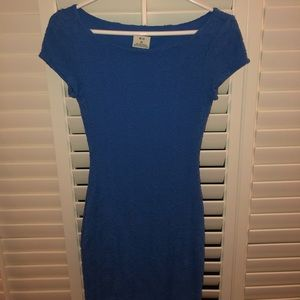 Blue body con dress with flower detailing